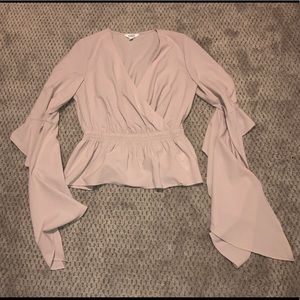 Surplice blouse with dramatic sleeves